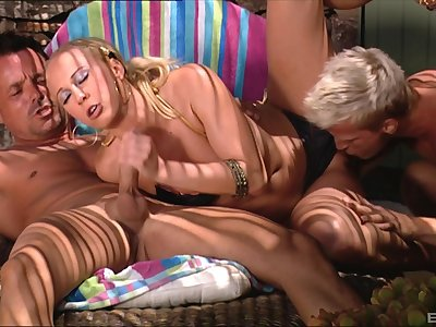 Blonde in a bikini Carla Cox double penetrated and doused with cum