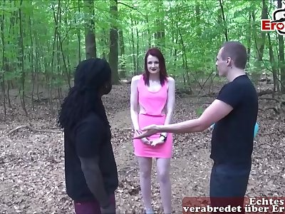 German skinny teen meets two big dicks in the forest