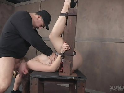 Teen in a miniskirt Nora Riley cries in an abusive bondage scene