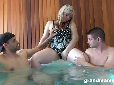 Big mature lady Marta is having crazy lovemaking fun with two young guys