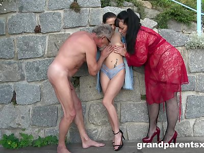 Old couple's sexy outdoor threesome amusement with brunette babe