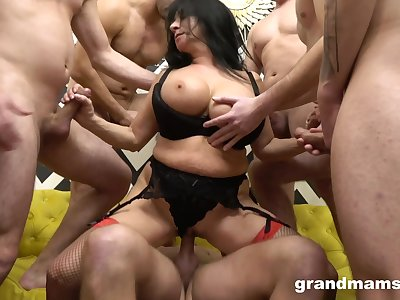Fine MILF rides cock and strokes some others anent working gangbang special